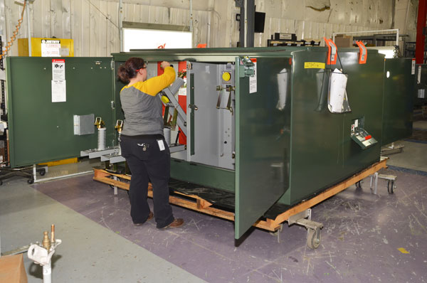 Padmount Assembly Associate inspecting unit prior to final test